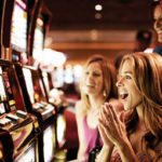 Women playing the slot machines inside MGM Grand